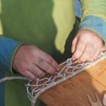 Fischer beim Netz knüpfen